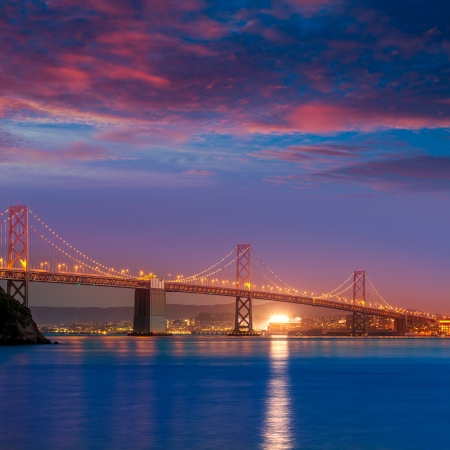 Bay Bridge at sunset in San Francisco from Treasure Island California USA photo