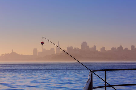 San francisco fog skyline with fishing rod in the mist California USA photo