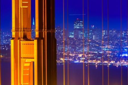 san francisco golden gate bridge: San Francisco Golden Gate Bridge sunset view through cables in California USA
