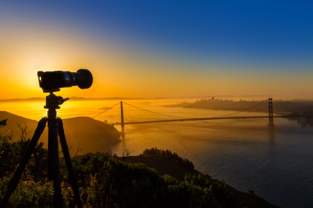 Golden Gate Bridge San Francisco sunrise California USA with photo camera silhouette photo