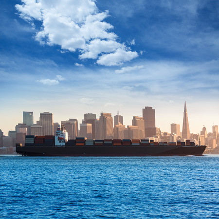 San Francisco Skyline with merchant ship cruising bay at California USA Stock Photo - 25143764