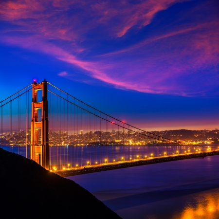 Golden Gate Bridge San Francisco sunset view through cables in California USA photo