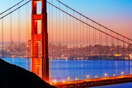 san francisco golden gate bridge: San Francisco Golden Gate Bridge sunrise view through cables in California USA Stock Photo