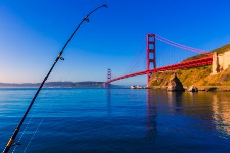 san francisco golden gate bridge: San Francisco Golden Gate Bridge with fishing rod California USA
