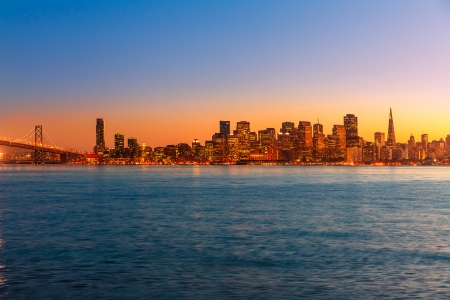 frisco: San Francisco sunset skyline in California with reflection in bay water USA Stock Photo