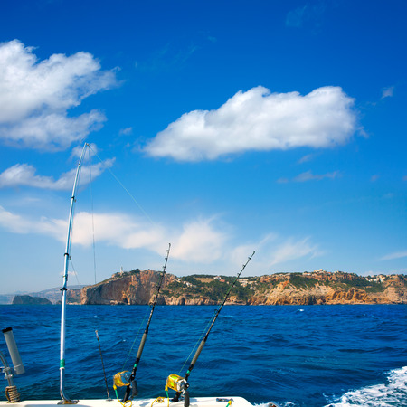 trolling: Fishing trolling boat rods in Mediterranean Cabo Nao Cape at Alicante Spain