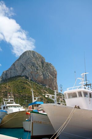 Calpe Alicante fisherboats with Penon de Ifach in Mediterranean Spain photo
