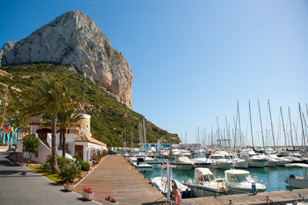 Calpe Alicante marina boats with Penon de Ifach mountain in Mediterranean sea of Spain photo