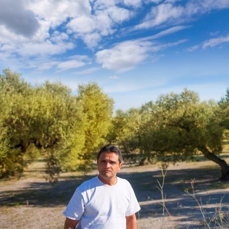 latin farmer in Mediterranean Olive tree field of Spain photo