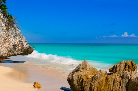 tulum: Tulum beach near Cancun turquoise Caribbean water and blue Sky