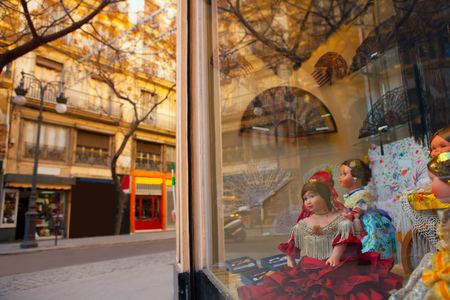 souvenir traditional: Valencia Calle san Vicente with Falleras dolls and spanish fan in Spain
