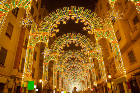 street party: Beautiful night lights in Fallas fest of Valencia in calle Sueca street Spain
