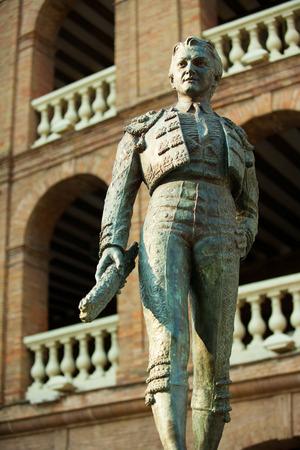 plaza de toros: Plaza de toros de Valencia bullring with toreador statue of Manolo Montoliu