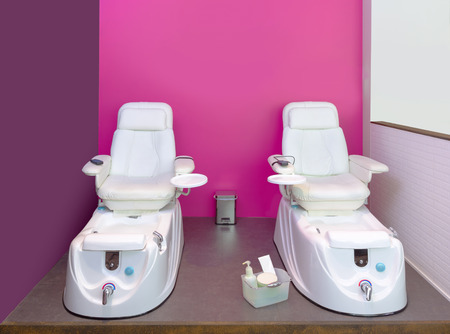 two chairs: Nail saloon Pedicure chair spa furniture in pink purple wall
