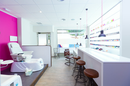 Nail saloon and pedicure chair spa modern with nail polish colorful in a row on white background photo