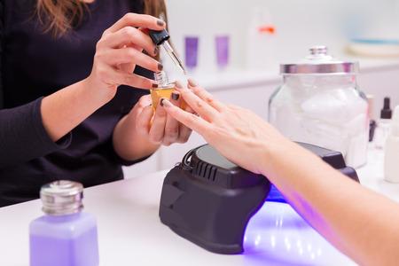 Nail saloon UV lap of quick dry nail polish manicure photo