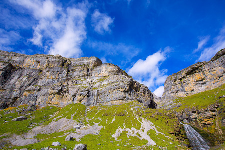 cascade range: Cascada Cola de Caballo waterfall and Circo de Soaso at Ordesa Valley Aragon Huesca Pyrenees of Spain