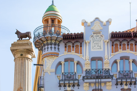 carlos: Aragon Teruel El Torico statue and modernist building in Plaza Carlos Castel square at Spain