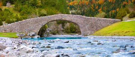 nicolas: Rio Ara river and bridge San Nicolas de Bujaruelo in Ordesa Aragon Huesca Spain Stock Photo