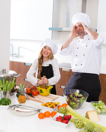 Chef master and junior kid girl at cooking school crazy man about pupil recipe photo