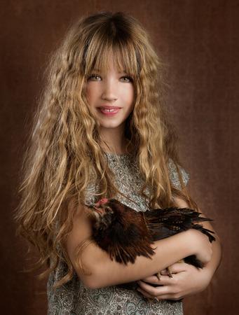children fashion farmer girl holding hen in retro vintage background photo