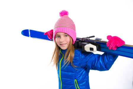 pink hat: Blond kid girl winter snow holding ski equipment with pink wool hat