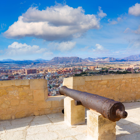 Alicante skyline and old canyons of Santa Barbara Castle in Spain photo