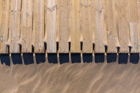 pine wood deck weathered in beach sand pattern texture detail photo