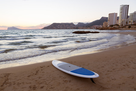 cantal: Calpe Alicante sunset at beach Cantal Roig in Mediterranean Spain with paddle sufboard