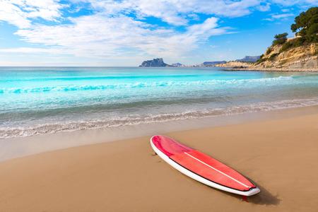 Moraira playa El Portet beach with paddle surfboard at Alicante Spain