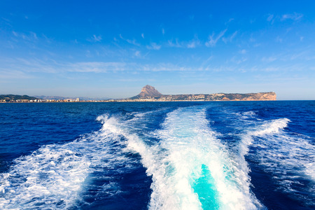 mongo: javea with mongo and san antonio cape from boat in mediterranean sea