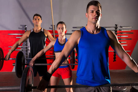 Barbell weight lifting group workout exercise at gym box photo