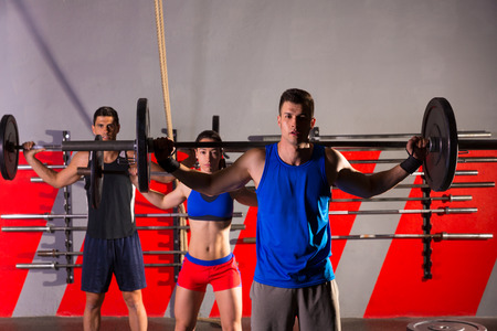 cross bar: Barbell weight lifting group workout exercise at gym box
