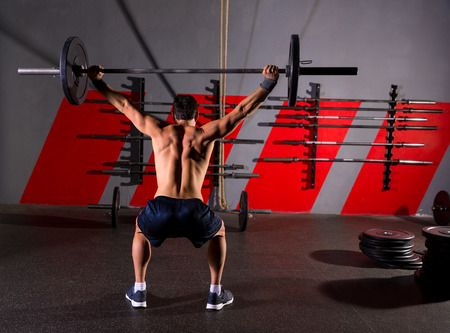 weight lifting: barbell weight lifting man rear view back workout exercise at gym box Stock Photo
