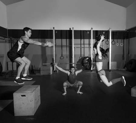 gym people group workout barbells slam balls and jump exercises photo