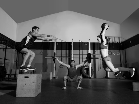 gym people group workout barbells slam balls and jump exercises