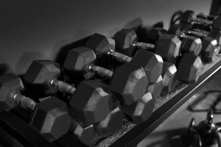 Dumbbells and Kettlebells weight training equipment at gym photo