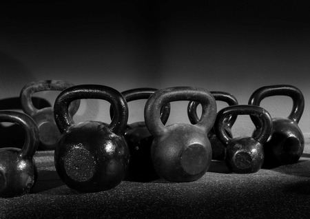 Kettlebells weights in a workout gym in black and white