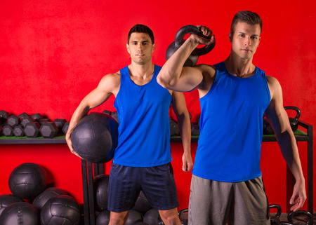 Kettlebell and weighted ball workout training men at gym photo