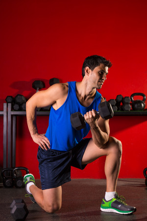abdominal wall: Hex dumbbells man workout in red gym floor Stock Photo
