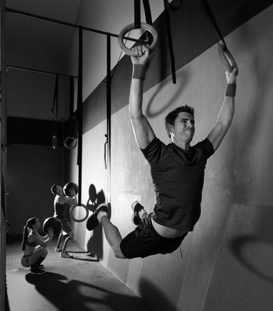 Muscle ups rings man swinging workout exercise at gym photo