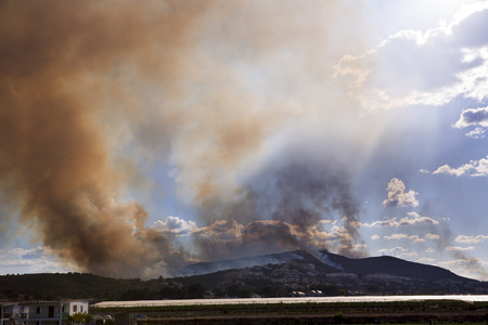CUMBRES DE CALICANTO, TORRENT, VALENCIA, SPAIN - April 22, 2014  Fire burning mountain forest and village, hundred of arson people in Torrent, Cumbres de Calicanto, Valencia, Spain - April 22, 2014