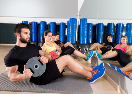 fitness instructor: Abdominal plate training core group at gym fitness workout Stock Photo