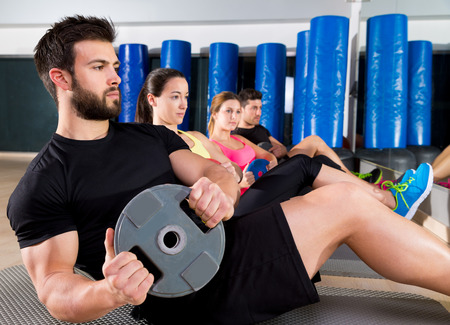 personal training: Abdominal plate training core group at gym fitness workout Stock Photo