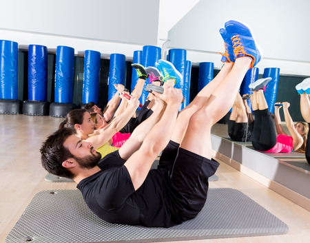 oblique: Abdominal plate training core group at gym fitness workout Stock Photo