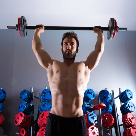 Barbell beard man workout fitness at weightlifting gym photo