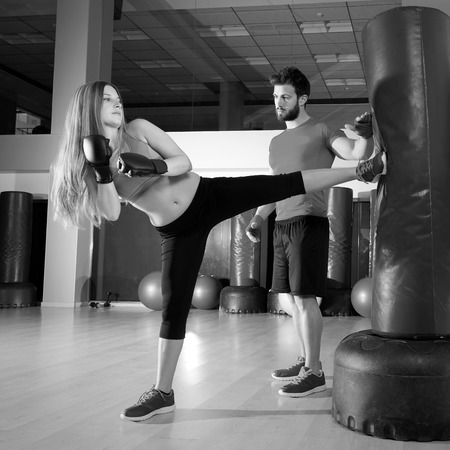 boxing training: Boxing aerobox blond girl with personal trainer man at fitness gym