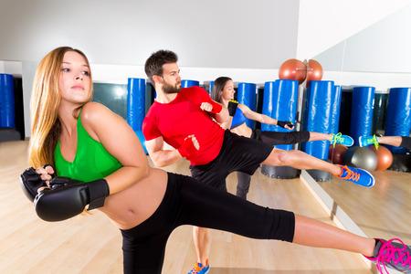 Boxing aerobox group low kick training at fitness gym mirror photo