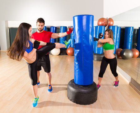 Boxing aerobox women group with personal trainer man at fitness gym photo