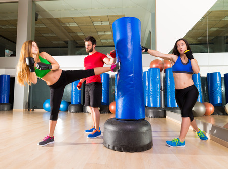 female boxing: Boxing aerobox women group with personal trainer man at fitness gym